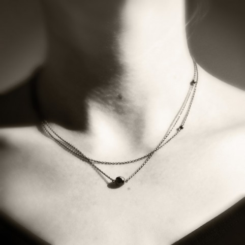 Asymmetrical necklace with doublechain and hematite beads