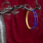 Pure titanium hoop earrings with blue and gold glass beads