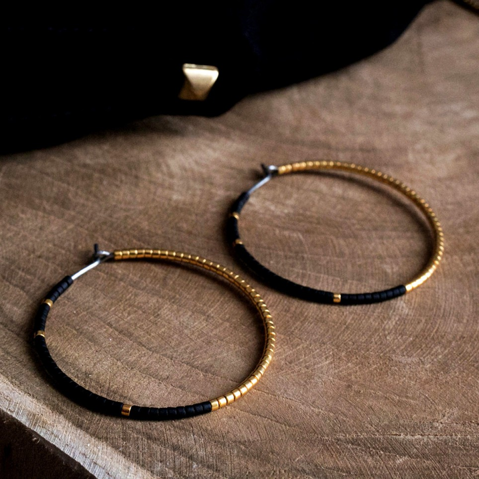 Pure titanium hoop earrings with black and gold glass beads - hypoallergenic earrings
