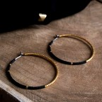 Pure titanium hoop earrings with black and gold glass beads