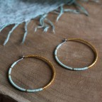 Pure titanium hoop earrings with light green and gold glass beads - hypoallergenic - for sensitive ears